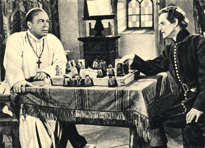 Несмотря на то, что церковные власти нередко выступали против шахмат, в монастырях охотно играли в шахматы. Кадр из немецкого фильма 'Монастырский ловчий' (1953 год, ФРГ)