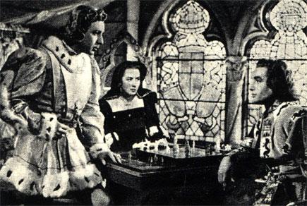 Партия в шахматы в старой Испании. Кадр из исторического испанского фильма 'Напиток любви' (1953 год)