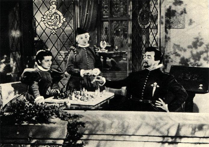 В царствование королевы Елизаветы шахматы пользовались в Англии большим успехом. Сцена из американского фильма 'Морской ястреб' (1942 г.)