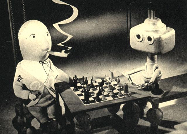 Партия в шахматы с электронным роботом в сцене из польского кукольного фильма 'Привидение во дворце'